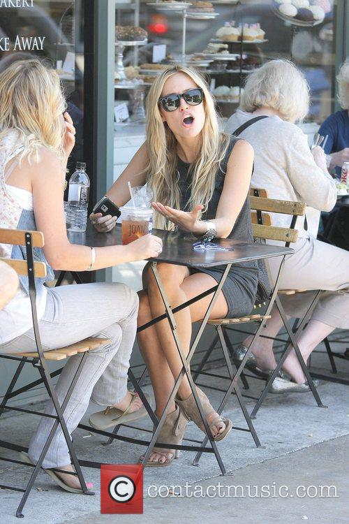 Kristin Cavallari eating lunch with a friend at...