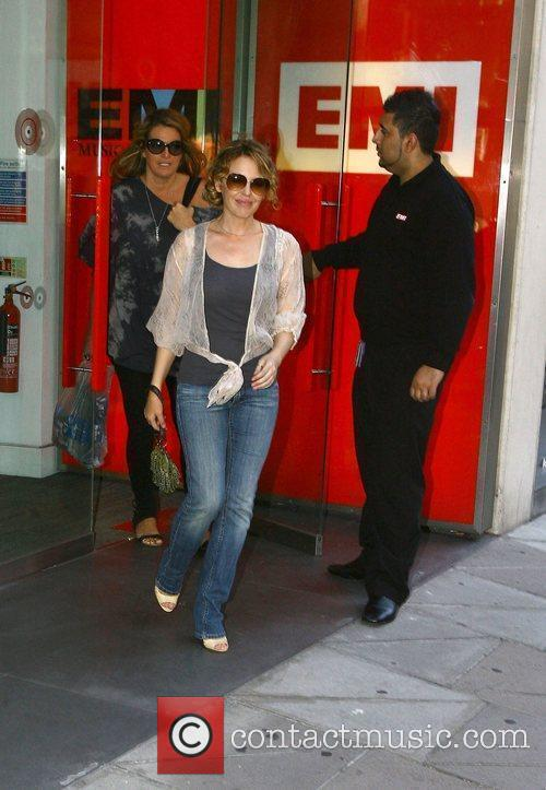 Leaving her record company offices