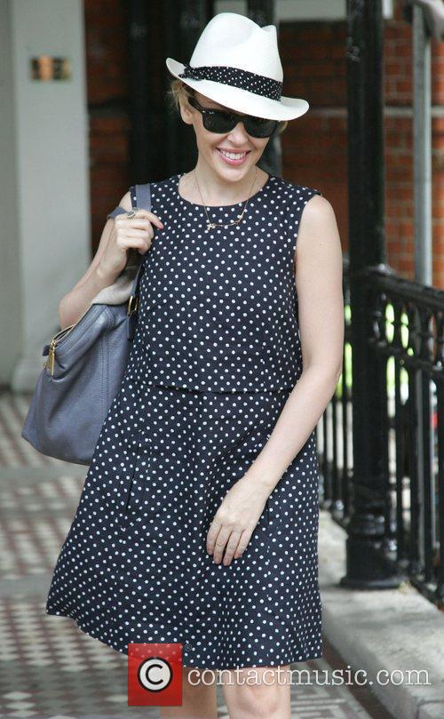 Kylie Minogue leaving home in a polkadot dress...