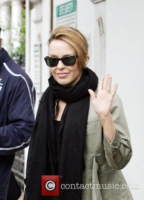 Kylie Minogue leaves her house and heads for...