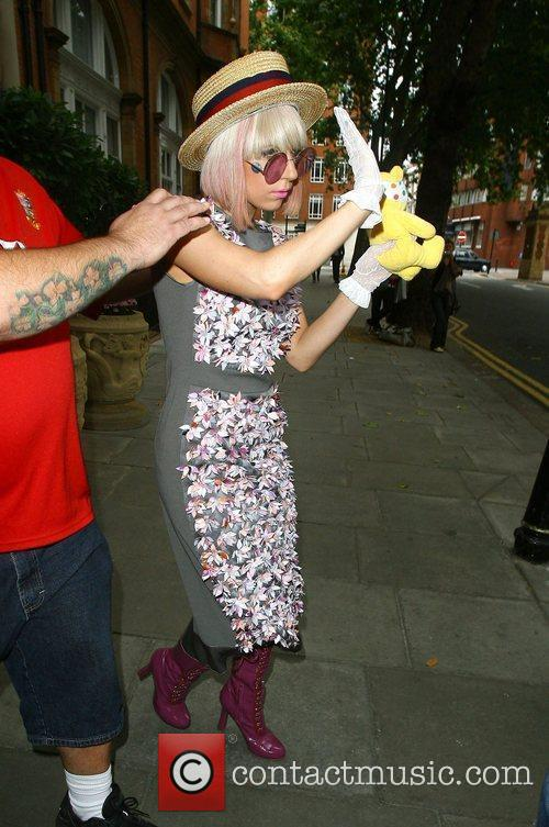 Lady Gaga leaving her hotel carrying a Pudsey...