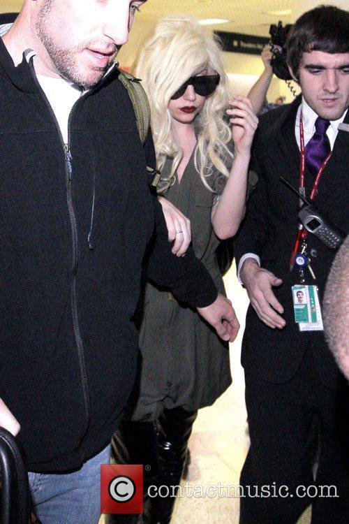 Lady Gaga is surrounded by paparazzi as she...