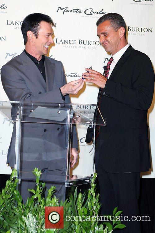 Monte Carlo President and COO Anton Nikodemus signs...