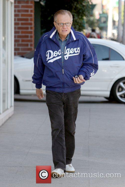 Wearing a Los Angeles Dodgers jacket while outside...