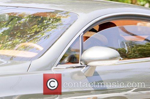 La Toya Jackson driving a Bentley as she...