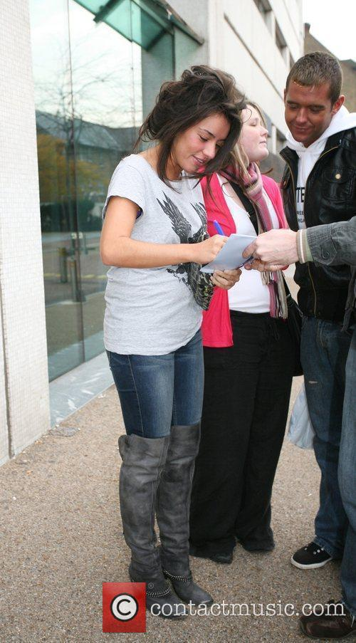 Former X Factor finalist Laura White signs autographs...