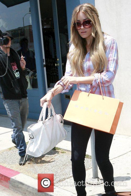 'The Hills' star Lauren Conrad carrying a shopping...