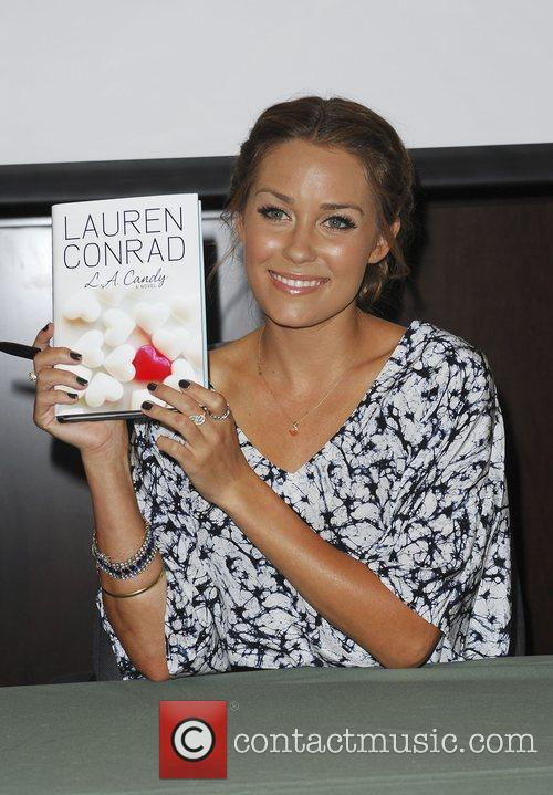 Signing copies of her new book 'L.A Candy'...