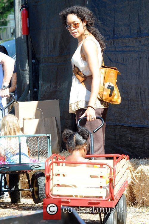 Shopping at the pumpkin patch with her daughter,...