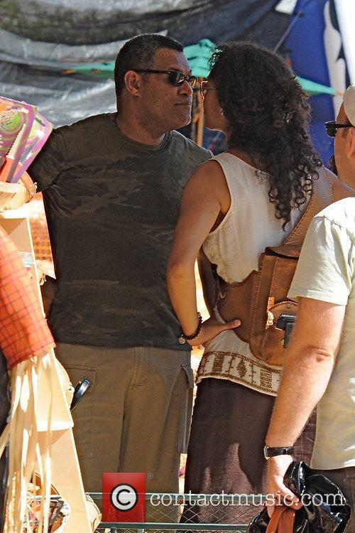 Laurence Fishburne and Gina Torres shopping at the...