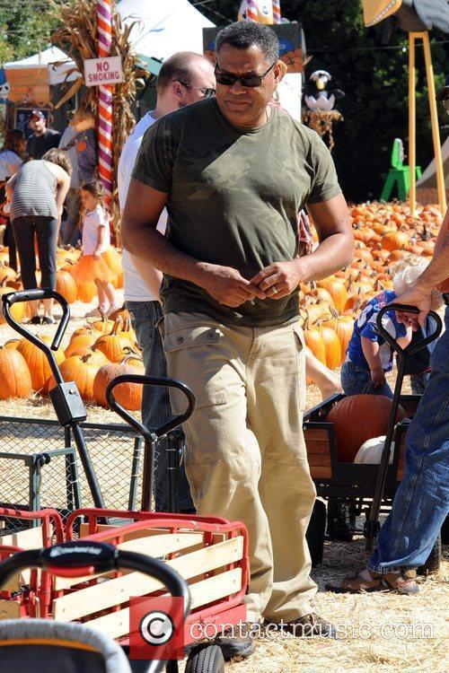 Laurence Fishburne shopping at the pumpkin patch with...