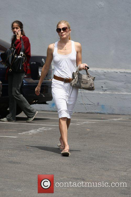 LeAnn Rimes, wearing an all white summer dress, makes her way to Brentwood Art Center