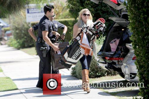 Santa Monica police officers help LeAnn Rimes unload...