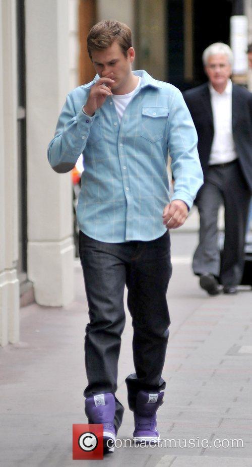 Lee Ryan sporting a pair purple high top...