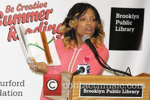 Rapper Lil Mama  reads to children at...