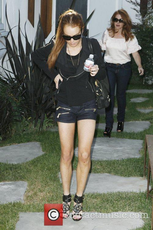 Lindsay Lohan seen leaving a jewelry store in...