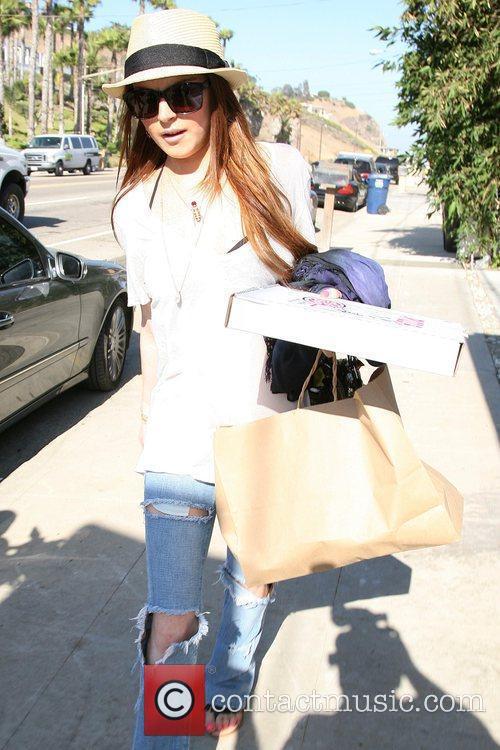 Lindsay Lohan wearing ripped jeans, arrives in Malibu...