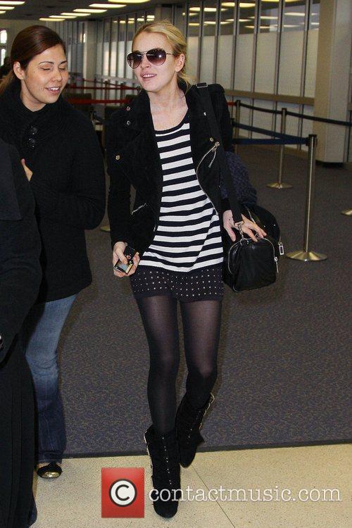 Lindsay Lohan going through security at JFK airport...