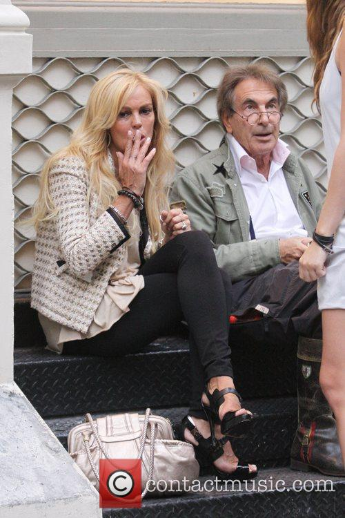 Has a cigarette break outside of a Soho...