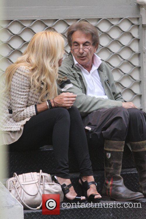 Dina Lohan  has a cigarette break outside...