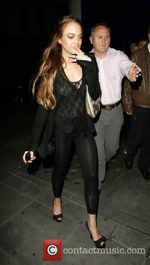 Lindsay Lohan out having dinner in Soho with...