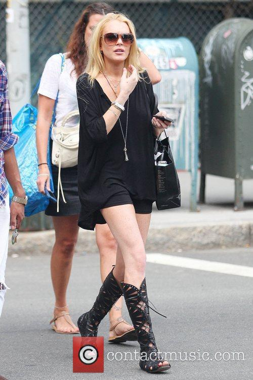 Lindsay Lohan, Wearing A Little Black Dress, Knee-high Strappy Boots and Visits Ina In Soho For A Spot Of Retail Therapy 10