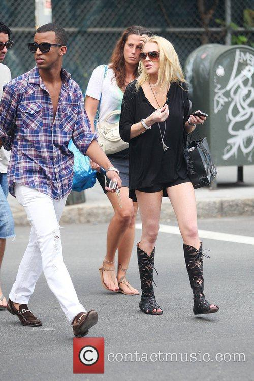 Lindsay Lohan, Wearing A Little Black Dress, Knee-high Strappy Boots and Visits Ina In Soho For A Spot Of Retail Therapy 2