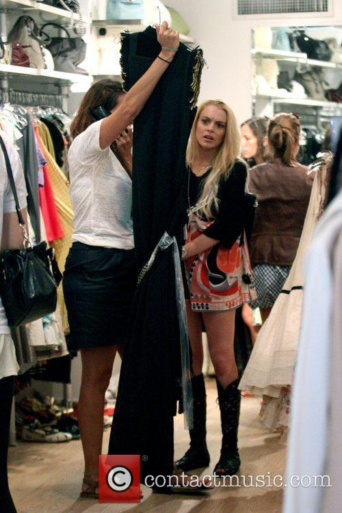 Lindsay Lohan wearing strappy boots, visits Ina in...