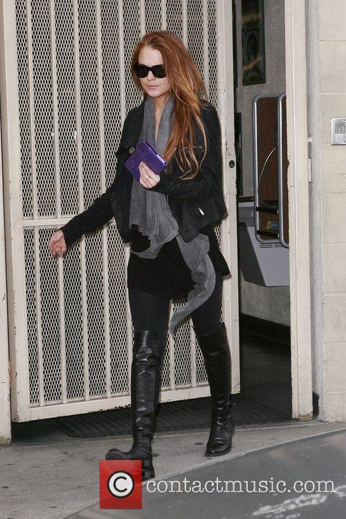 Lindsay Lohan stops by Hollywood Tow on her...