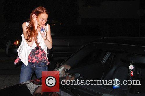 Lindsay Lohan arriving at Samantha Ronson's residence after...