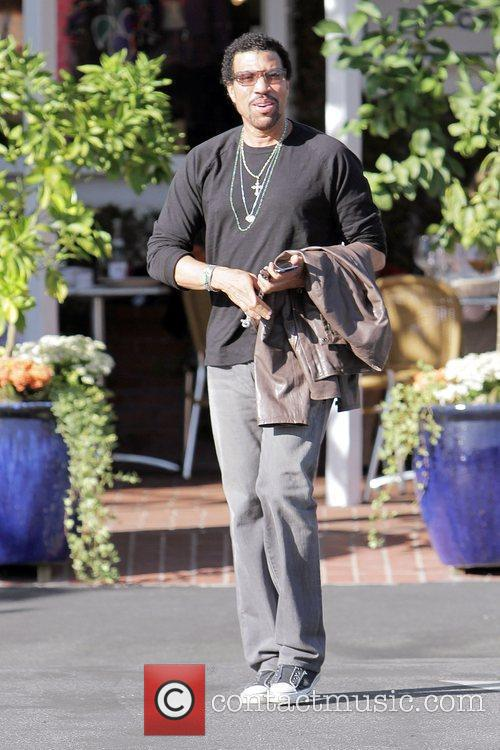 Lionel Richie leaving Fred Segal on Melrose Avenue...