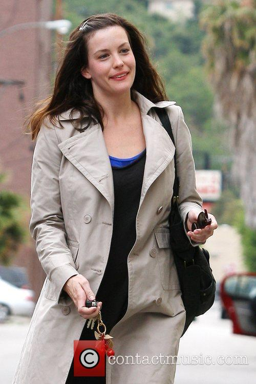 Liv Tyler makes her way to her car...