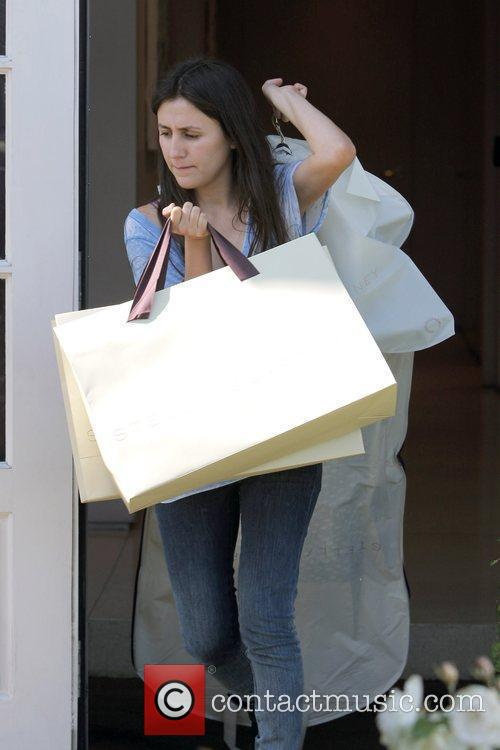 Liv Tyler's shopping assistant carrying shopping bags Los...