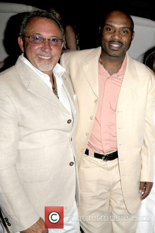 Emilio Estefan and Tim Hardaway attend a party...