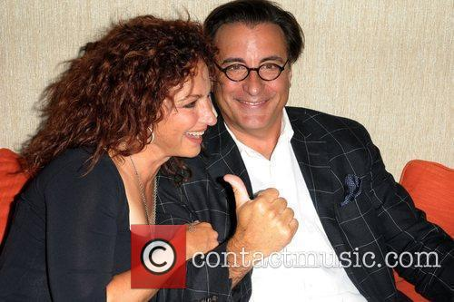 Gloria Estefan and Andy Garcia attend a party...