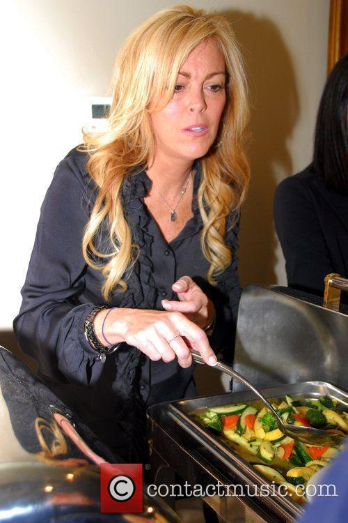 Dina Lohan and family join community leaders in...