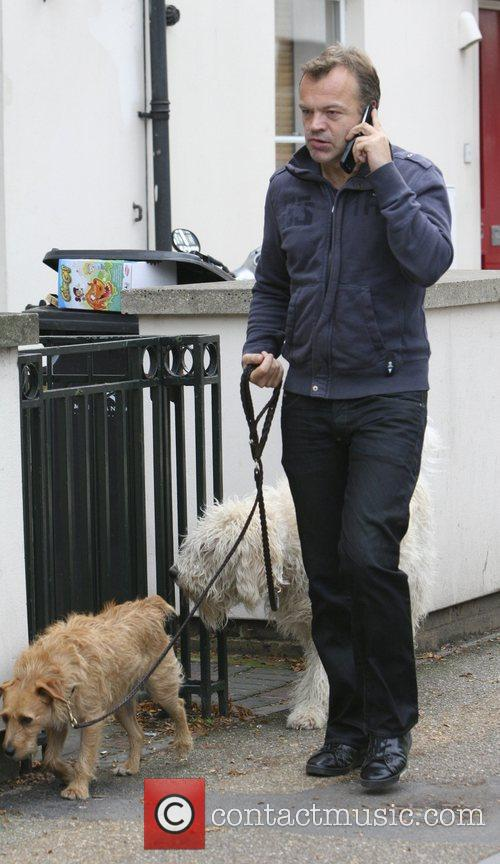 Graham Norton walking his dogs outside the London...