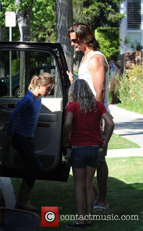 Lorenzo Lamas takes his daughters Alexandra and Victoria...