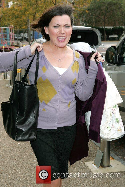 Lorraine Kelly has her hands full carrying her...