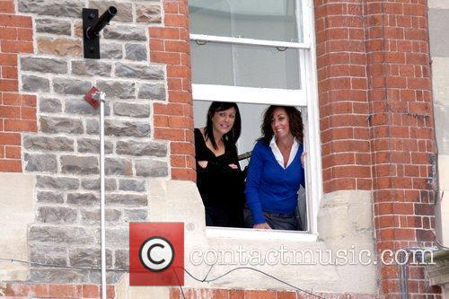 Fans watch from a nearby window former contestant...