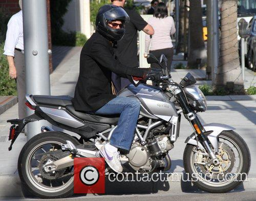 Was spotted riding on his motorcycle in Beverly...