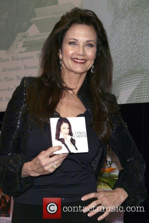 Lynda Carter performs and signs copies of her...