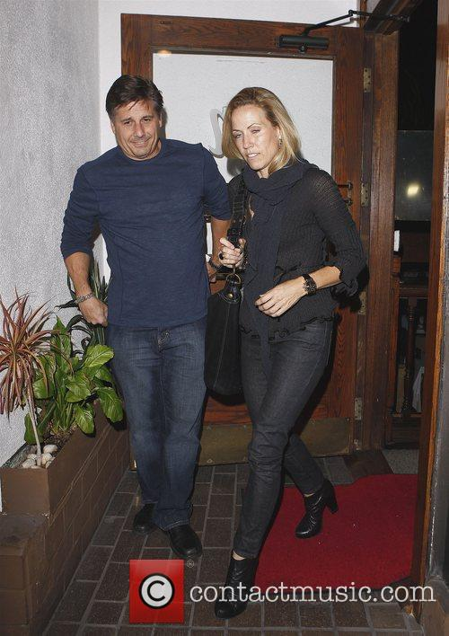 Leaving Madeo restaurant with a friend