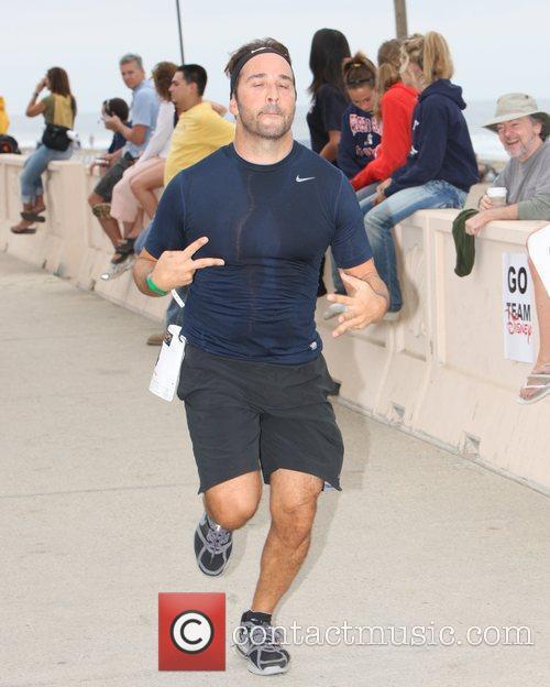 Competes in the Malibu Triathlon.