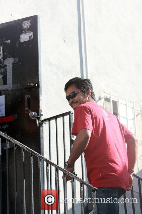 Filipino professional boxer Manny Pacquiao goes to the...