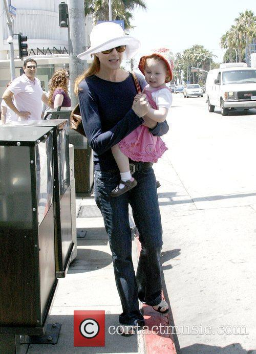 Marcia Cross walking with her daughters in Hollywood...