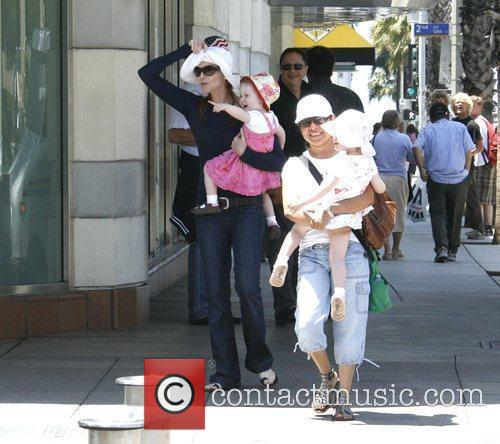 Marcia Cross walking with her daughters Eden and...