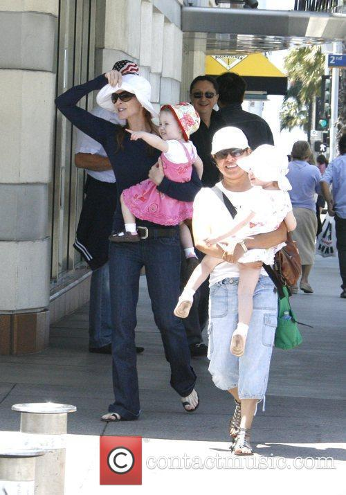 Walking with her daughters Eden and Savannah in...