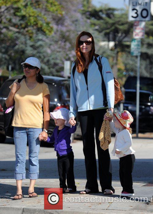 Marcia Cross out shopping with her twin daughters...