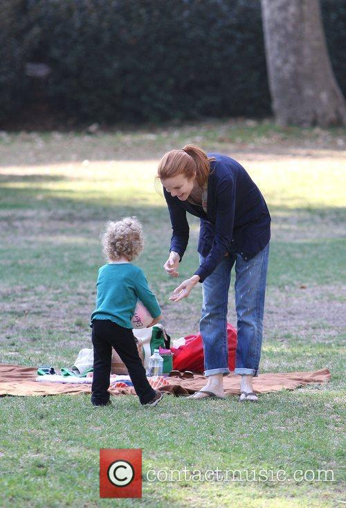 Marcia Cross takes her twin daughters Eden and...